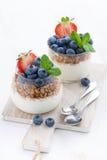Diet dessert with yogurt, muesli and fresh berries. On wooden board, vertical Stock Photos