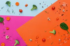 Raw vegetables on abstract background, flat lay. Diet, detox and healthy food concept - top view flat lay of fresh organic raw vegetables on abstract bright Stock Images
