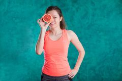 Diet. Dieting concept. Healthy Food. Beautiful Young Female with grapefruit . Weight Loss royalty free stock photo