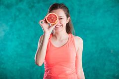 Diet. Dieting concept. Healthy Food. Beautiful Young Female with grapefruit . Weight Loss royalty free stock image