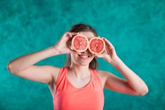 Diet. Dieting concept. Healthy Food. Beautiful Young Female with grapefruit . Weight Loss stock images