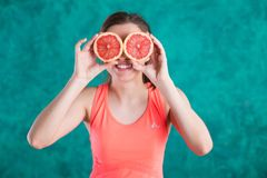 Diet. Dieting concept. Healthy Food. Beautiful Young Female with grapefruit . Weight Loss stock photography