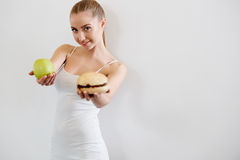 Diet. Dieting concept. Healthy Food. Beautiful Young Woman choos Stock Photos