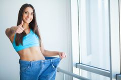 Diet. Dieting concept. Woman in Sportswear Measuring Her Waist stock photography