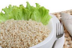 Diet dish of boiled wholefood rice with salad isol Stock Image