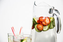 Diet drink with ice. Without calories. Water with lemon strawberries and cucumber Royalty Free Stock Photos