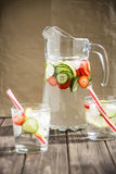 Diet drink with ice. Without calories. Water with lemon strawberries and cucumber Royalty Free Stock Photo