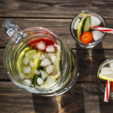 Diet drink with ice. Without calories. Water with lemon strawberries and cucumber Stock Photo