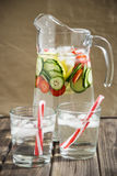 Diet drink with ice. Without calories. Water with lemon strawberries and cucumber Stock Photos