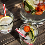 Diet drink with ice. Without calories. Water with lemon strawberries and cucumber Royalty Free Stock Photography