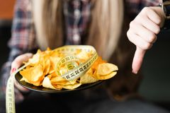 Diet eat food thumb down chips healthy lifestyle stock image