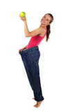 Diet effect. Women with too big trousers Royalty Free Stock Photos