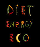 Diet, energy, eco. Studio photography of food words - on black background Royalty Free Stock Photos