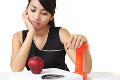 Diet or exercise. Young asian lady on diet and exercise concept Stock Images