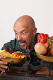 Diet failure. Guy about to fail in his effort to keep up a diet Royalty Free Stock Image