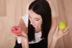 Diet And Fast Food Concept. Overweight Woman Standing On Weighin Royalty Free Stock Image