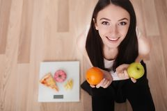 Diet And Fast Food Concept. Overweight Woman Standing On Weighin Stock Photo