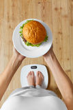 Diet, Fast Food. Overweight Woman On Scale, Hamburger. Junk Food Stock Photography