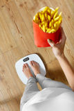 Diet, Fast Food. Woman On Scale, French Fries. Obesity. Stock Images