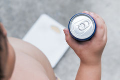 Diet. fat boy holding soft drink can. Stock Photography