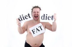 Diet and fat guy. Big man on a diet trying to lose weight. Stress and willpower. The problem - overweight Royalty Free Stock Photography