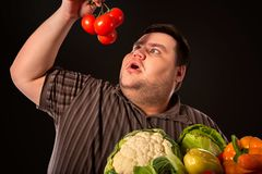 Diet fat man eating healthy food . Healthy breakfast with vegetables. Diet fat man eating healthy food. Stop obesity concept. Health breakfast with vegetables stock photography