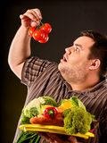 Diet fat man eating healthy food. Healthy breakfast with vegetables. royalty free stock photo