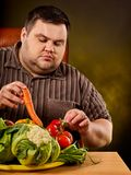 Diet fat man eating healthy food. Healthy breakfast vegetables cauliflower. Royalty Free Stock Photography