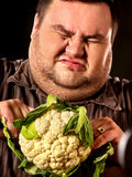 Diet fat man eating healthy food. Healthy breakfast vegetables cauliflower. Stock Photography