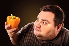 Diet fat man eating healthy food. Healthy breakfast with vegetables. Stock Image