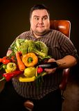 Diet fat man eating healthy food. Healthy breakfast with vegetables. Stock Photography