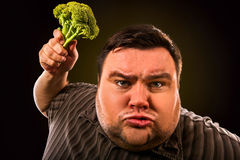 Diet fat man eating healthy food . Healthy breakfast with vegetables. Diet fat man eating healthy food . Health breakfast with vegetables broccoli for stock photos