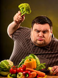 Diet fat man eating healthy food. Healthy breakfast with vegetables. Royalty Free Stock Image