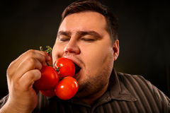 Diet fat man eating healthy food . Healthy breakfast with vegetables. Stock Images