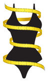 Diet figure. Measuring tape and female figure as a conceptual diet icon Royalty Free Stock Photography