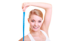 Diet. fit girl with measure tape isolated Royalty Free Stock Images