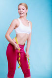 Diet. fit girl with measure tape measuring waist Stock Photo