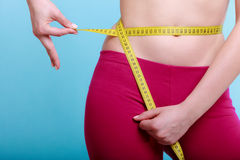 Diet. fit girl with measure tape measuring waist Royalty Free Stock Photos