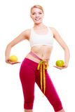 Diet. Fit girl with measure tapes citrus fruits Stock Photos