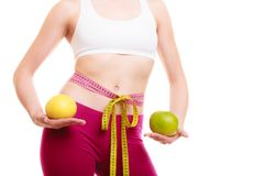 Diet. Fit girl with measure tapes citrus fruits Royalty Free Stock Image