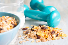Diet and fitness concept with dumbbells and muesli Royalty Free Stock Photos