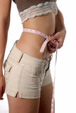 Diet and fitness pays off. Female waist being measured metric measurement Royalty Free Stock Images