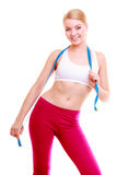 Diet. Fitness woman fit girl with blue measure tape Royalty Free Stock Photography