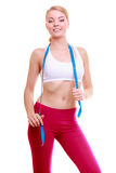 Diet. Fitness woman fit girl with blue measure tape Stock Photography