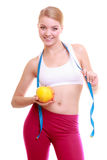 Diet. Fitness woman fit girl with measure tape and apple fruit Royalty Free Stock Image