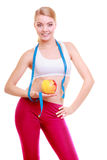 Diet. Fitness woman fit girl with measure tape and apple fruit Stock Image