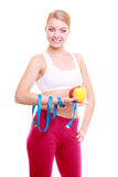 Diet. Fitness woman fit girl with measure tape and apple fruit Royalty Free Stock Photos
