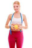 Diet. Fitness woman fit girl with measure tape and apple fruit Stock Photos