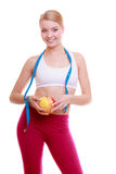 Diet. Fitness woman fit girl with measure tape and apple fruit Royalty Free Stock Images