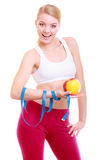 Diet. Fitness woman fit girl with measure tape and apple fruit Royalty Free Stock Photography